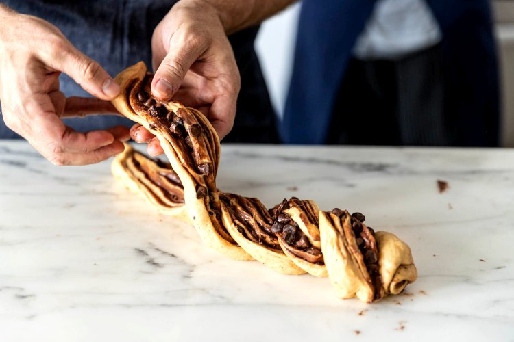 Image of Twist the two halves together, keeping the exposed chocolate layers...