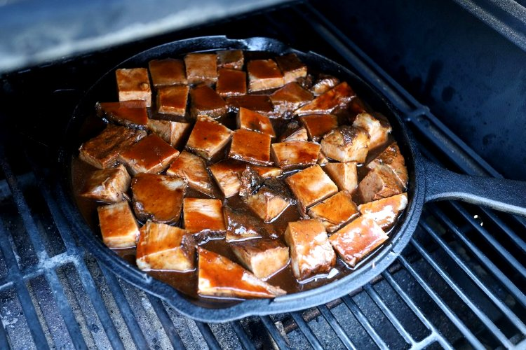 Image of Place skillet on the grill grate, over indirect heat. Cook...