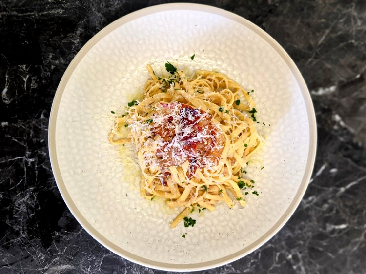 Image of Transfer your carbonara to a bowl and top with an...