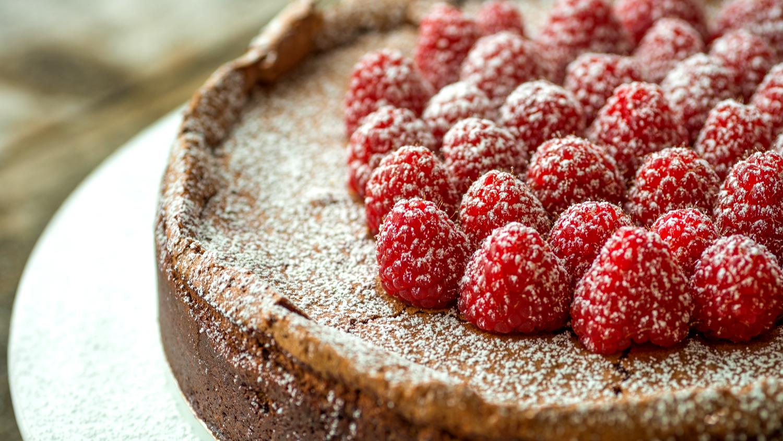 Image of Decadent Flourless Chocolate Cake with Raspberries