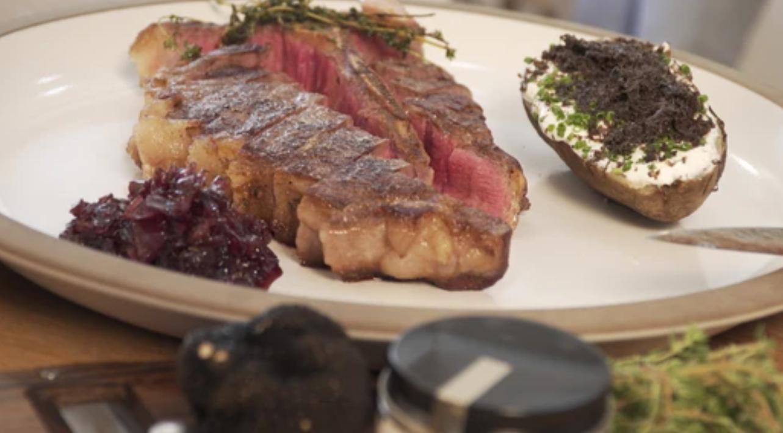 Image of Roasted Porterhouse Steak  with Twice Baked Potato and Black Truffle Jus