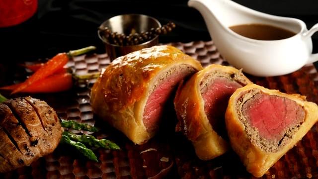 Image of Beef Wellington with Truffle and Mushroom Jus