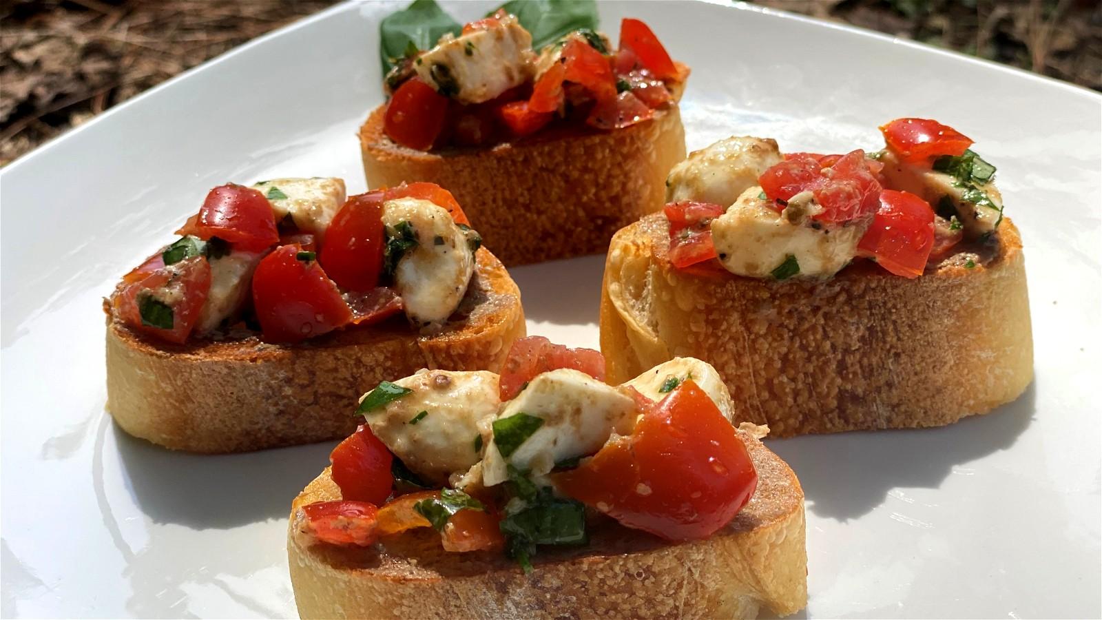 Image of Tomato Mozzarella Bruschetta with White Truffle Sauce
