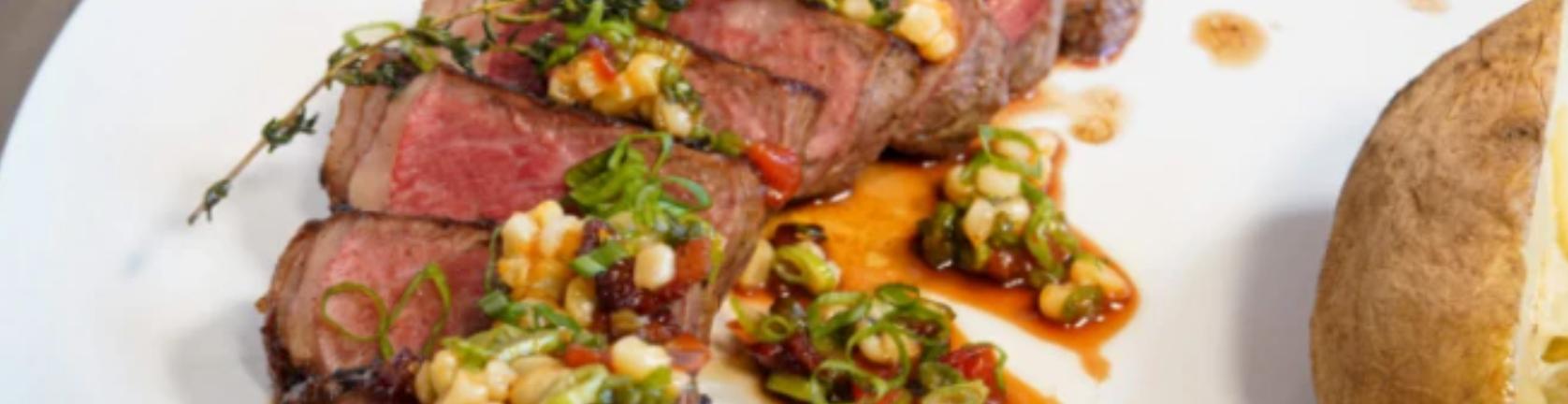 Image of Pan-Seared NY Strip Steak with Truffle Corn Succotash