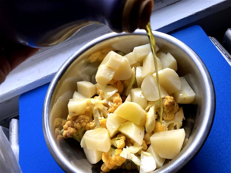Image of Toss the potato and cauliflower pieces with olive oil, the...