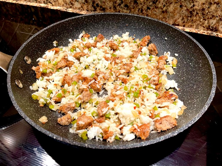 Image of Mix the rice with the sausage mixture in the frying...
