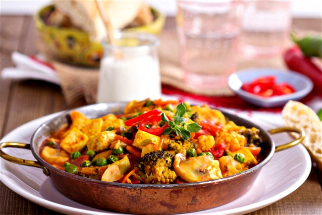 Image of Slow Cooked Tandoori Tofu, Green Peas, Peppers and Parsnips