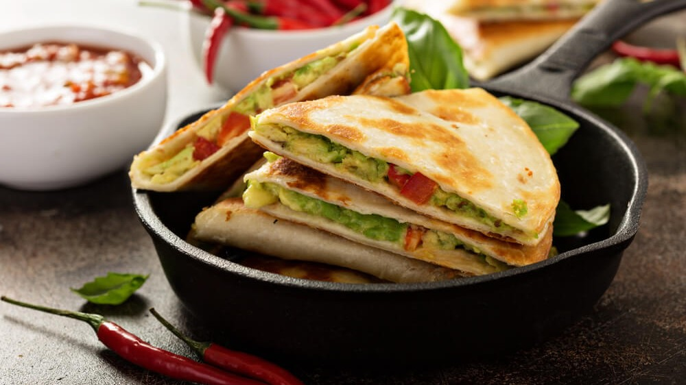 Image of Vegan Quesadillas: Spicy Black Beans, Guacamole, and Cheese!