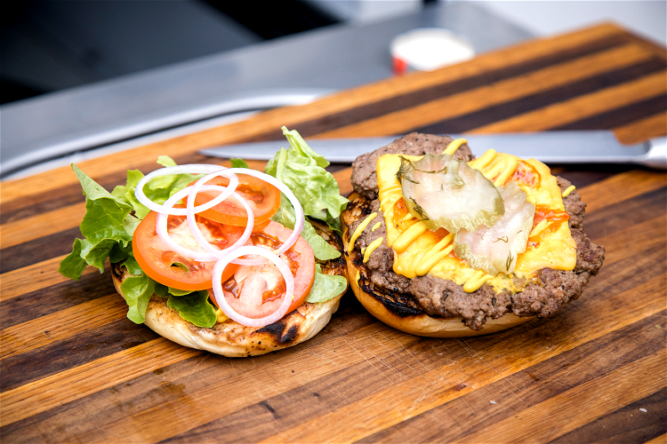 Image of Add your burger patty to the base, top with two...
